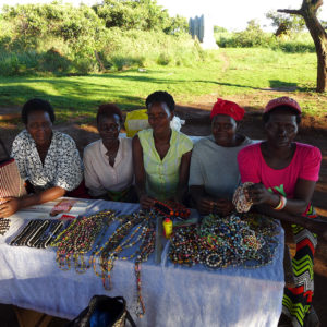 Some of the women of the Kwagaalama Handicraft Association with their paper bead jewelry on the island of Myende. In order from left to right: Ruth, Hajara, Hawa, Amina and Regina.